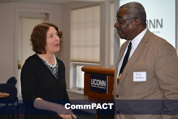 michele femc-bagwell speaking with male attending commpact event