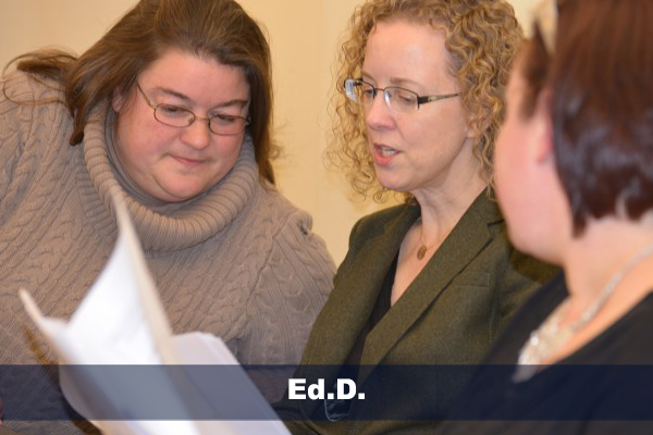 jen michno and ann traynor looking at papers during edd class