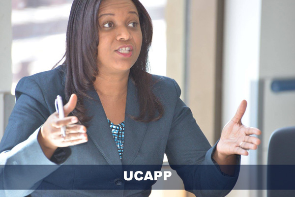 UCAPP female student engaging in discussion during class