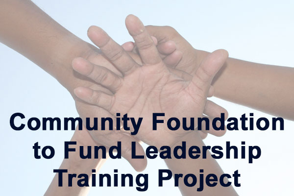 Hands together in honor of teamwork for a local grant awarded to Jen Michno