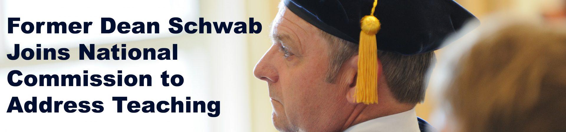 dean schwab in graduation hat looking at speaker