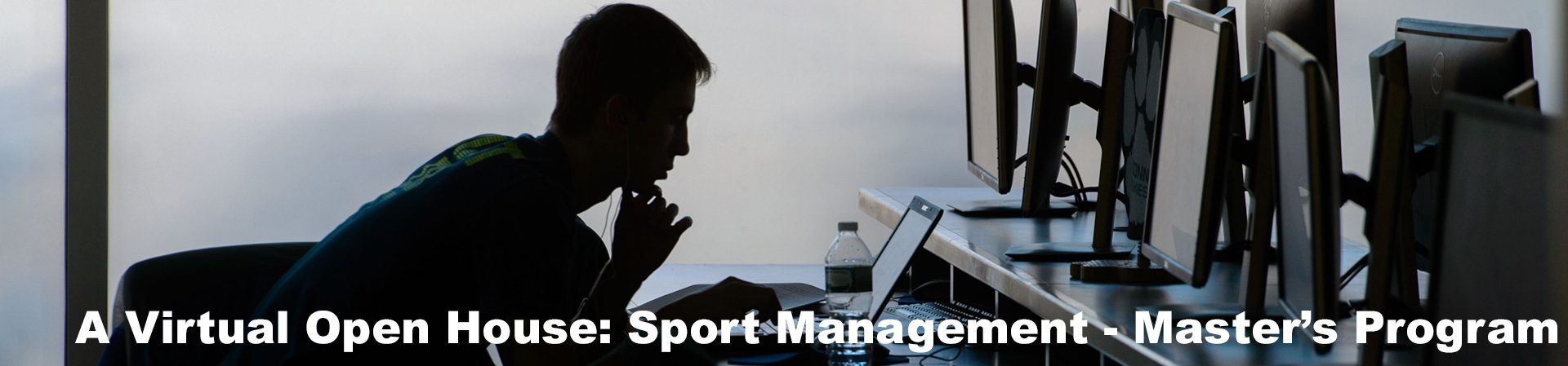 sport management master's student looking at laptop