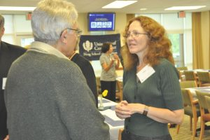 Lisa Nesbitt conversing with a collague