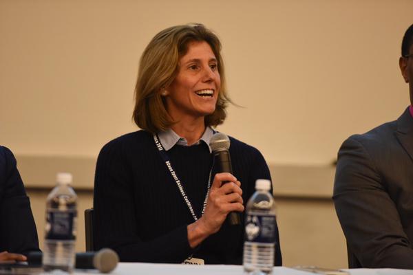 Dr. Laura Burton delivering a speech