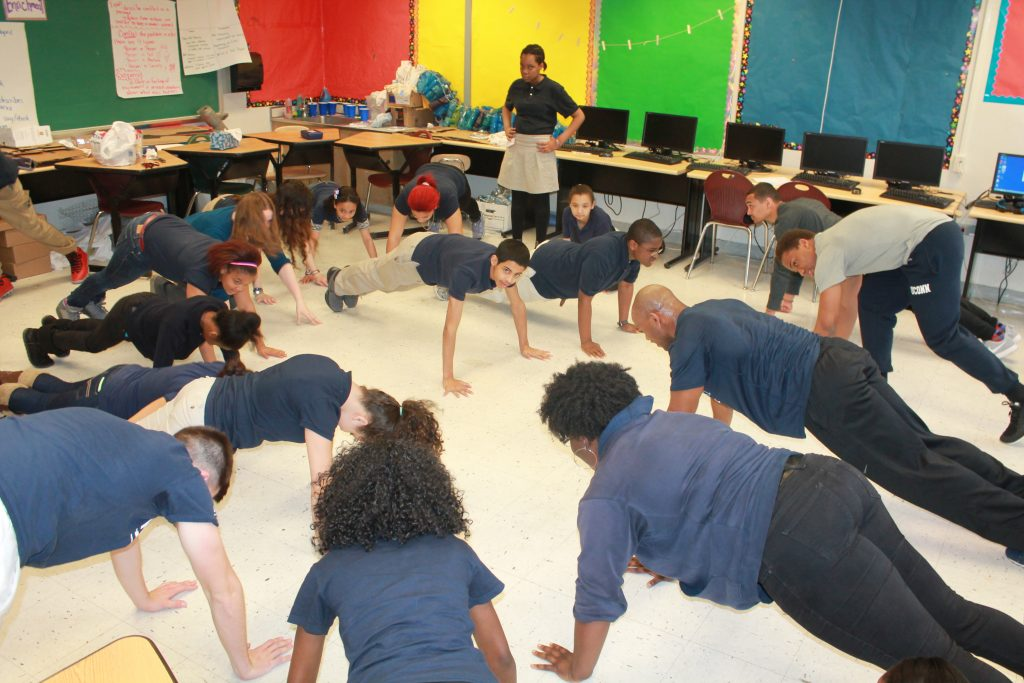 Husky Sport students in a Classroom doing Push-ups