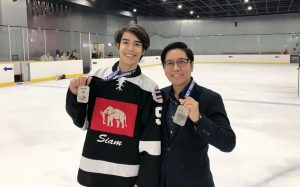 "Dr. Tra Giang ""Jane"" Nguyen with Men's Hockey Player"