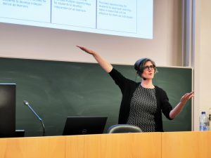 Sarah Woulfin giving a lecture on principals' work in implementing evaluation