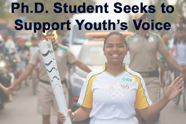 UConn alumna Pauline Batista Souza da Silva carries the torch at the 2016 Olympic Games in Rio.  Text reads: Ph.D. Student seeks to support youth's voice